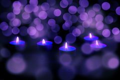Candles at wooden table Royalty Free Stock Photography