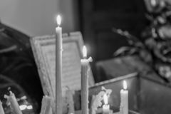 Candles and written prayer royalty free stock photography