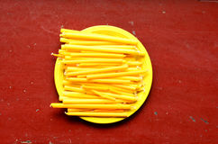 Candles. On the yellow dish with red background royalty free stock photography