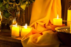 Candles and yellow fabric ornament stock image