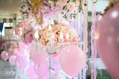 The candlesicks and balloon decorate in backdrop wedding. The candlesicks decorate together with flowers arrangment and balloons in wedding reception stock photography