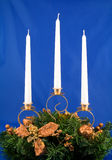 Candlestick. Christmas candlestick on blue background Royalty Free Stock Images