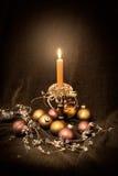 Candlestick arrangement. Romantic Christmas arrangement with old brass candlestick and glass balls royalty free stock images