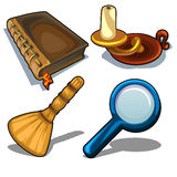 Candlestick, book, magnifying glass and droom Stock Images