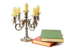 Candlestick and books Stock Photography