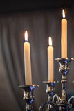 Candlestick. With bright lighted candles stock image