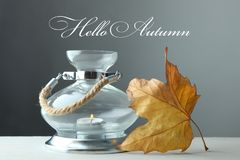Candlestick with a burning candle and a maple leaf Royalty Free Stock Photo
