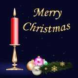 Red_candle. Candlestick with a burning red candle, a Christmas ball set, a fir-tree branch with golden snowflakes and a gold inscription Merry Christmas on a Stock Photos