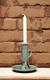 Candlestick with a candle Royalty Free Stock Images