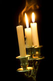 Candlestick with candles Stock Images
