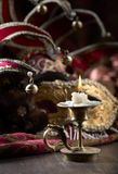 Candlestick and carnival masks . Royalty Free Stock Photography