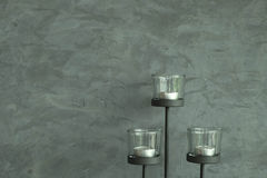 Candlestick and cement wall background. Candlestick and old cement wall background Stock Photo