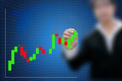 Candlestick chart and business hand. Royalty Free Stock Image