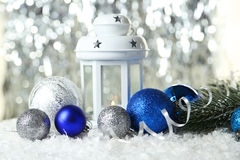 Candlestick with christmas ball on lights background, close up Stock Photography