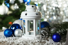 Candlestick with christmas ball on wooden background Royalty Free Stock Photo