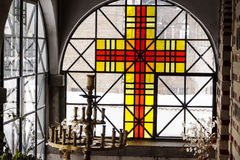 Candlestick and cross  in a  church Stock Photos