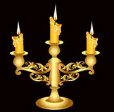 Candlestick gold(en) with three burning candle Stock Image