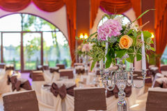 Candlestick hall arrangements. Table arrangements and decoration details in a big reception hall Stock Image