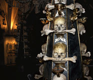 Candlestick with human skulls and bones Royalty Free Stock Photography