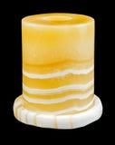 Candlestick made of onyx isolated on black background Stock Photo
