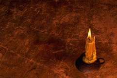 Candlestick over old oak background. Royalty Free Stock Photography