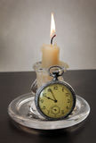 Candlestick and Pocket Watch Royalty Free Stock Photos
