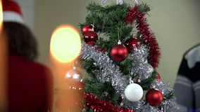 Candlestick refocus to Christmas tree close up stock footage