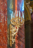 Candlestick in the Roman Catholic Church of St. Stephen's Basilica in Budapest, Hungary. BUDAPEST, HUNGARY - FEBRUARY 22, 2016: Candlestick in the Roman Catholic Royalty Free Stock Image