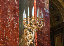 Candlestick in the Roman Catholic Church of St. Stephen's Basilica in Budapest, Hungary. BUDAPEST, HUNGARY - FEBRUARY 22, 2016: Candlestick in the Roman Catholic Stock Image