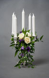 Candlestick. Silver candlestick with 5 white candles and bunch of flowers stock photo