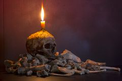 Candlestick skull and bones on dark background, Still Life style. Concept halloween day theme stock image