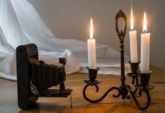Candlestick & Stara rocznik kamera Obraz Stock