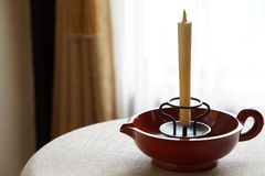 Candlestick in the room. Candlestick on the table in the room royalty free stock image