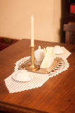 Candlestick, Teacups and Lace Doily. Candlestick, white teacups and crocheted table doily Royalty Free Stock Image