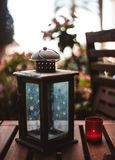 Candlestick on the terrace and red candle stock image