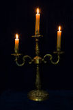 Candlestick with three burning candles Stock Image
