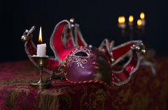 Candlestick and Venetian mask Royalty Free Stock Images