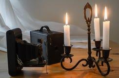 Candlestick & vintage cameras Stock Photos