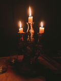 Candlestick in which three burning candles. Royalty Free Stock Photos