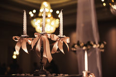 Candlesticks with candles in ballroom Stock Photography