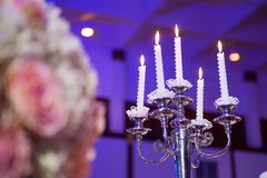 Candlesticks with candles in ballroom. The candlesticks with candles in ballroom, event stock image
