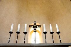 Candlesticks. With a cross in the middle stock photos
