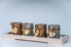 4 candlesticks dekorującego z sercem zdjęcie stock