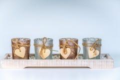 4 candlesticks dekorującego z sercem obrazy stock