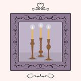 Candlesticks holders set with lit up candles inside a frame Stock Image