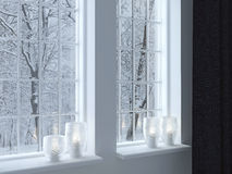 Candlesticks on a windowsill. Cozy room. Candlesticks on a windowsill. Winter landscape through the window stock images