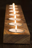 Candlight String. Candlelight as light string on a wood bar Stock Image