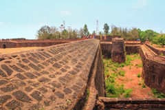 CANDOLIM, GOA, INDIA - 11 APR 2015: Ancient Fort Aguada and lighthouse built in the 17th century. Stock Photo
