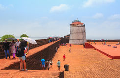 CANDOLIM, GOA, INDIA - 11 APR 2015: Ancient Fort Aguada and lighthouse built in the 17th century. Stock Images