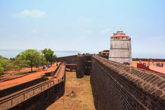 CANDOLIM, GOA, INDIA - 11 APR 2015: Fort Aguada and old lighthouse was built in the 17th century. Royalty Free Stock Photography